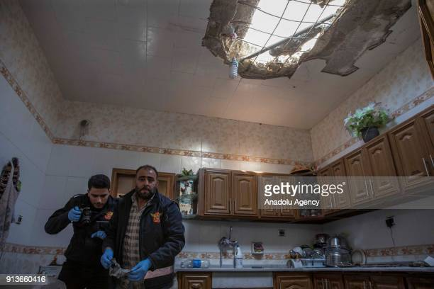 A ceiling of a damaged building is seen after PKK/PYD terror group fired seven missiles from Afrin region where Turkish Armed Forces conducts the...