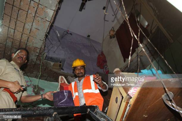 Ceiling slab fall down at Pradnya Dham building at Louis Wadi Thane on September 18 2018 in Mumbai India No one was hurt in the incident