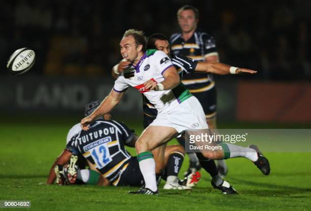Ceiron Thomas of Leeds offloads the ball as he is tackled by Willie Walker of Worcester during the Guinness Premiership match between Worcester...