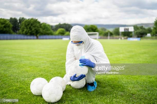 celaning soccer balls - football face mask stock pictures, royalty-free photos & images