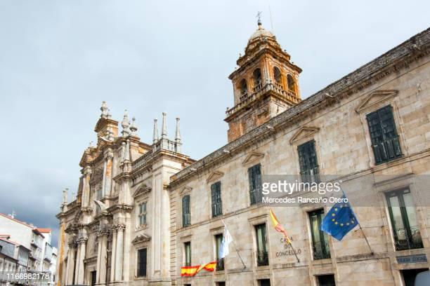 celanova, san salvador monastery church facade, bell tower and town hall, galicia, spain. - el salvador stock pictures, royalty-free photos & images
