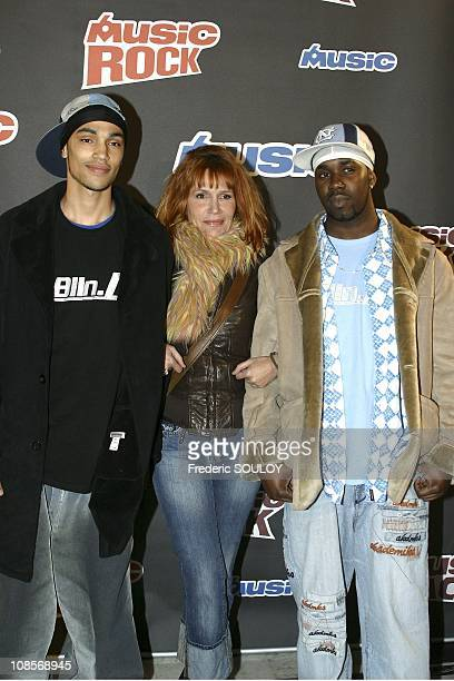 Celare Clementine his son Abraham Diallo and Johnson Telewane in Paris France on January 10th 2005