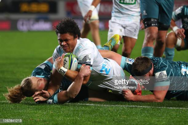 Celeb Clarke of the Blues dives over to score a try during the round 3 Super Rugby Aotearoa match between the Blues and the Highlanders at Eden Park...