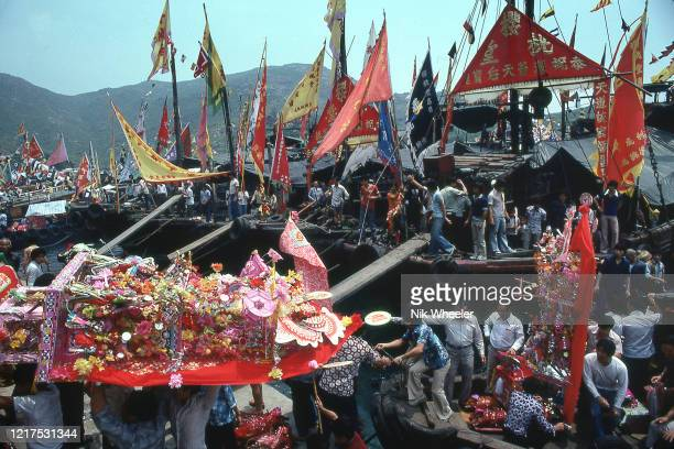 KONG JANUARY 1980 Celebrants carry paper shrines from boats to temple on Po Toi Island during festival dedicated to Goddess of Sailors and the Sea