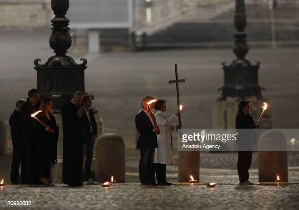 Celebrants walk in St. Peter's Square during the rehearsal of the Via Crucis torchlight procession presided by Pope Francis to commemorate the...