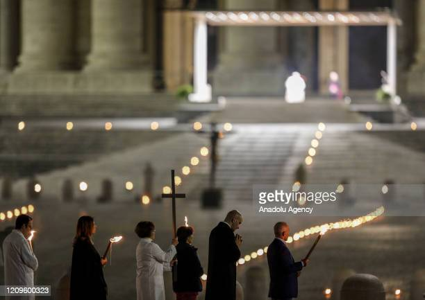 Celebrants walk in St Peter's Square during the rehearsal of the Via Crucis torchlight procession presided by Pope Francis to commemorate the...