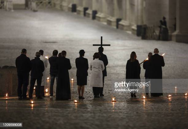 Celebrants walk in St Peter's Square during the Via Crucis torchlight procession presided by Pope Francis to commemorate the crucifixion of Jesus...