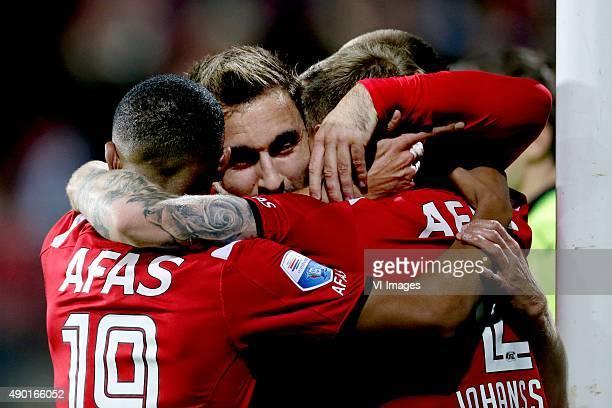 Celebrate 1-0 against Heracles Almelo Dabney dos Santos of AZ Alkmaar, Muamer Tankovic of AZ Alkmaar, Mattias Johansson of AZ Alkmaar, Markus...