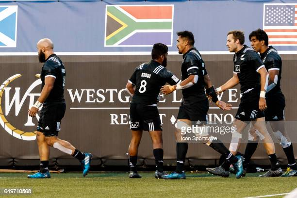 NZ celebrate a try by Dylan Collier during the Pool C match between New Zealand and Kenya at the HSBC Rugby Sevens Series held in Sam Boyd Stadium on...