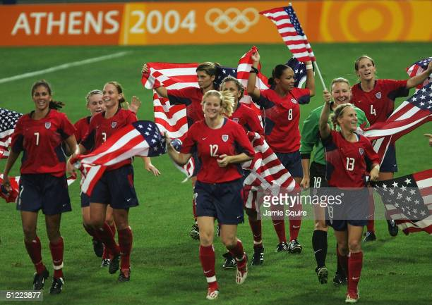 USA celebrate after beating Brazil 21 in extra time to win the Gold medal in the women's football gold medal match on August 26 2004 during the...