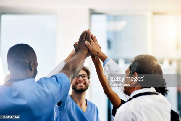 celebrate every medical success - medical team stock photos and pictures