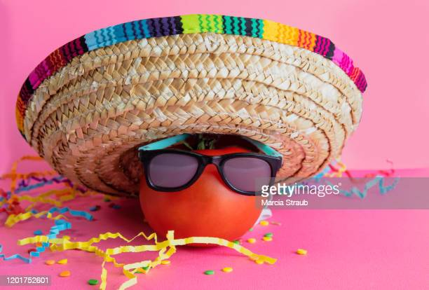 celebrate mexican holiday cinco de mayo with hot tomato and sombrero - cinco de mayo stock pictures, royalty-free photos & images