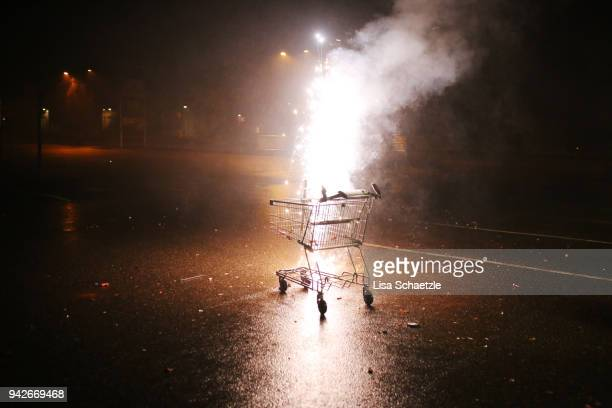 celebrate new year's eve with fireworks: firework in a shopping venture - riot stock pictures, royalty-free photos & images