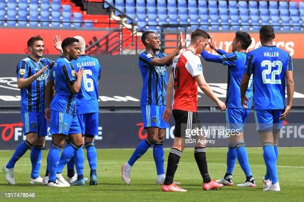Celebrate Ryan Gravenberch of Ajax, Edson Alvarez of Ajax during the Dutch Eredivisie match between Feyenoord and Ajax at de Kuip on May 9, 2021 in...