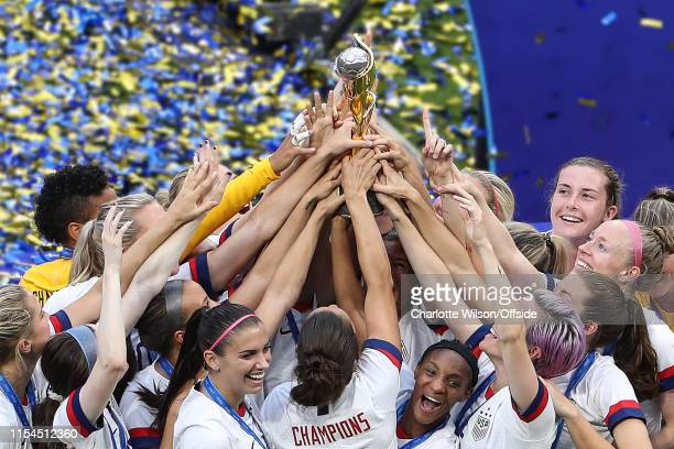 USA celebrate winning their 4th World Cup title with the trophy during the 2019 FIFA Women's World Cup France Final match between The United State of...