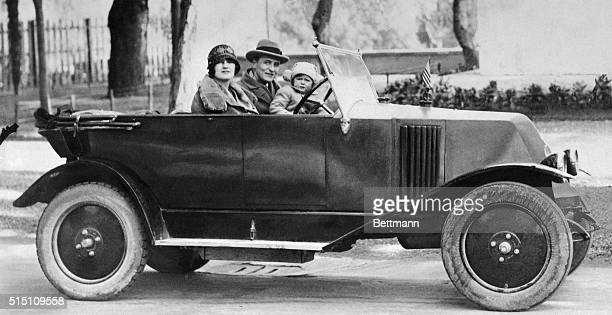Celebrated American novelist F. Scott Fitzgerald, his wife Zelda, and daughter, Scottie, go for a motor jaunt somewhere in Italy in this undated...
