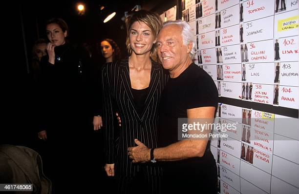 Celebrated fashion designer Giorgio Armani posing beside one of his most popular Italian model Martina Colombari who has in the last years undertaken...
