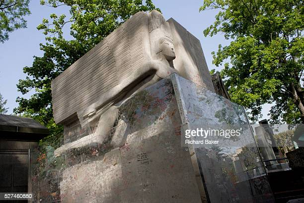 Celebrated grave for the Dublinborn playright and known homosexual Oscar Wilde in the Pere Lachaise cemetery Paris 19th century Irish playwright and...