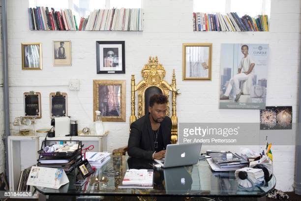 Celebrated South African fashion designer David Tlale works in his studio in Maboneng district on March 16 2016 in downtown Johannesburg South Africa...