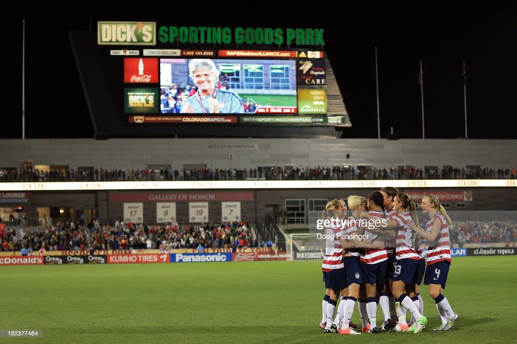 USA celebrates a goal by Shannon Boxx #7 of the USA in the 69th minute against Australia as USA head coach Pia Sundhage is seen on the jumbotron at Dick's Sporting Goods Park on September 19, 2012 in Commerce City, Colorado. It was Sundhage's final game as head coach for USA as they defeated Australia 6-2.