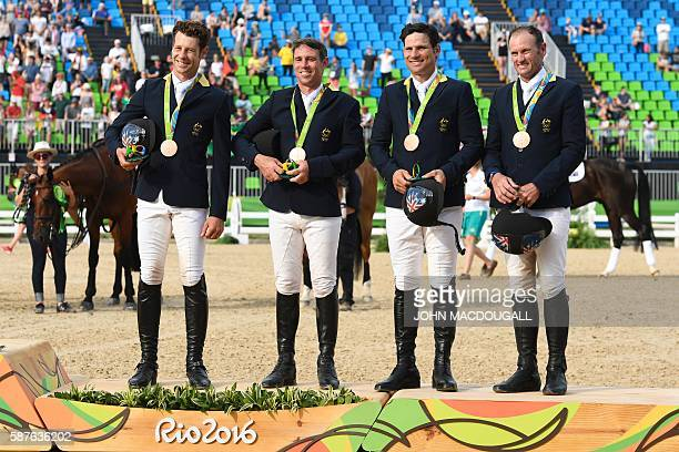 Celebrates on the podium of the Eventing's Jumping of the Equestrian during the 2016 Rio Olympic Games at the Olympic Equestrian Centre in Rio on...