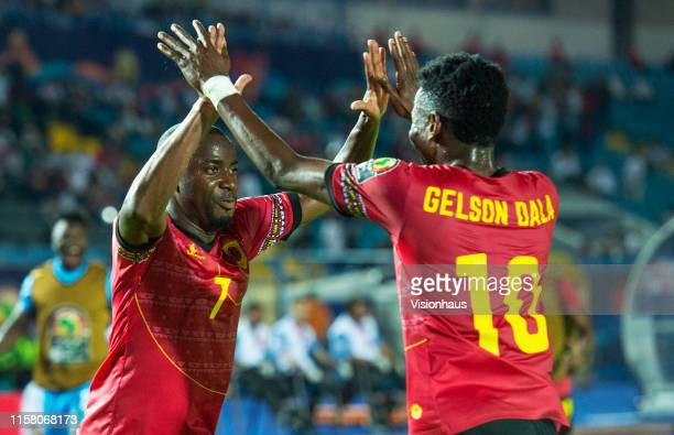 CAMPOS celebrates scoring for Angola with Gelson Dala during the 2019 Africa Cup of Nations Group E match between Tunisia and Angola at Suez Stadium...