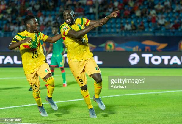 MAREGA celebrates scoring Mali's second goal with ABDOULAYE DIABY during the 2019 Africa Cup of Nations Group E match between Mali and Mauritania at...