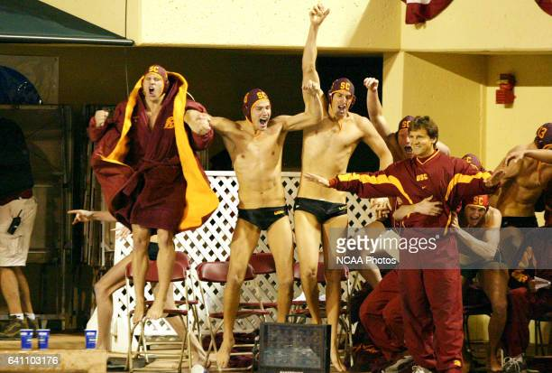 USC celebrates their victory over Stanford University during the Division I Men's Water Polo Championship held at the Avery Aquatic Center on the...