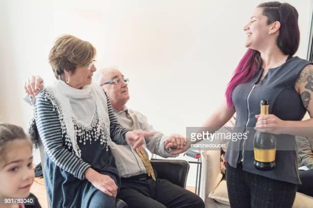 Celebrating active senior man 80th birthday in family reunion.