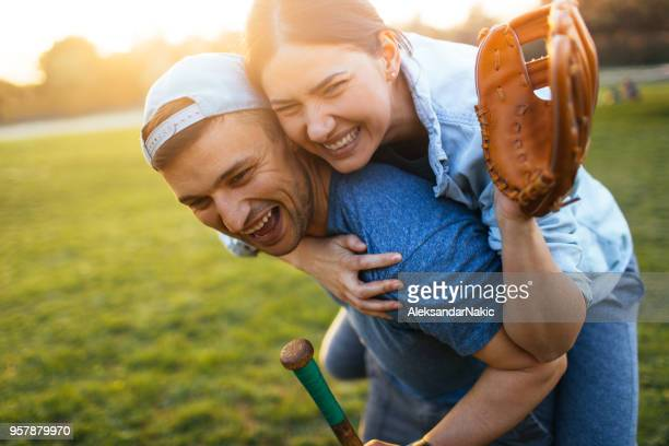 celebrating after a casual softball game - baseball glove stock pictures, royalty-free photos & images