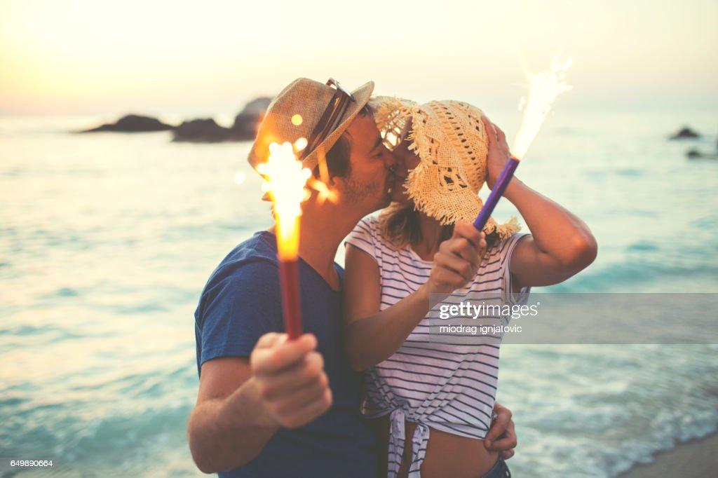 Celebrating Anniversary on the beach : Stock Photo