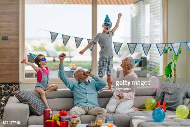 celebrating birthday at grandparent's house! - penthouse girls stock pictures, royalty-free photos & images