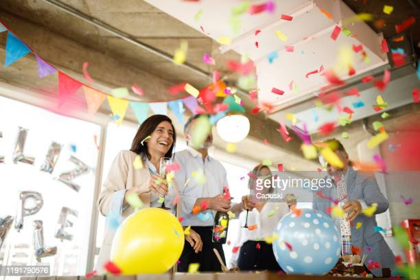 celebrating birthday with confetti - anniversary stock pictures, royalty-free photos & images