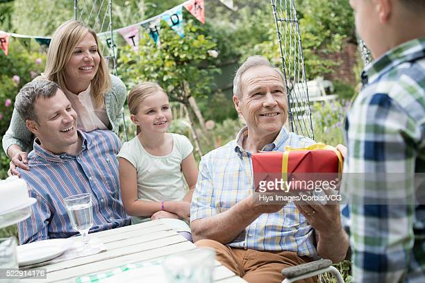 celebrating birthday with family in backyard (8-9, 10-12 years) - 55 59 years stock pictures, royalty-free photos & images