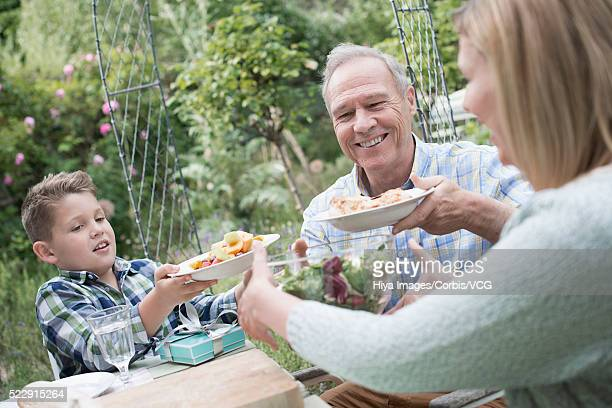 Celebrating birthday with family in backyard (10-12 years)