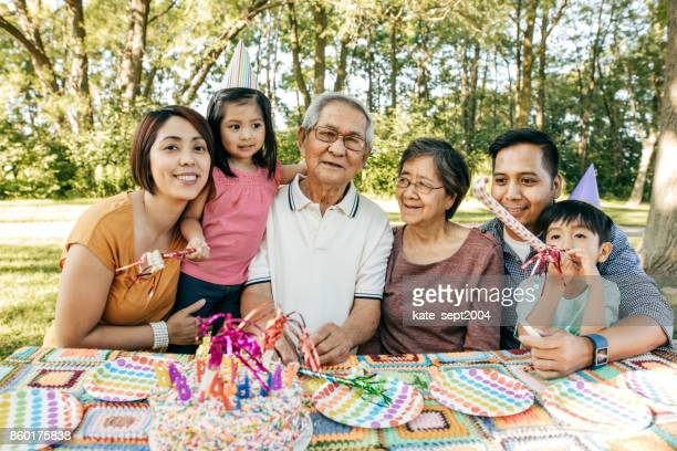 celebrating birthday with family - philippines family stock pictures, royalty-free photos & images