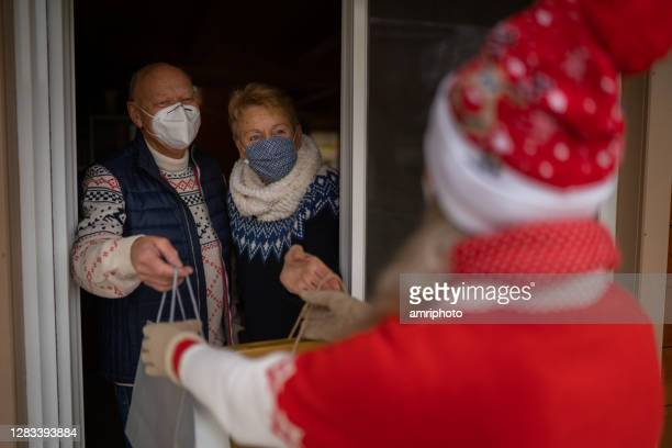 celebrating christmas holidays during covid at open patio door at home - 2020 stock pictures, royalty-free photos & images