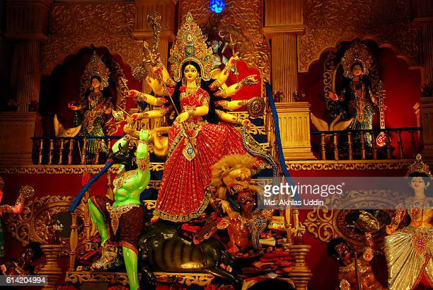 celebrating durga puja festival - durga stock photos and pictures