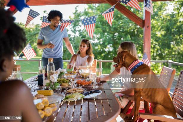 celebrating fourth july - fourth of july stock pictures, royalty-free photos & images