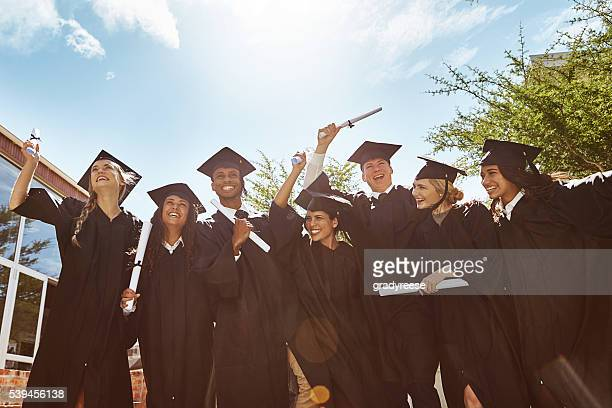celebrating graduation - graduation stock pictures, royalty-free photos & images