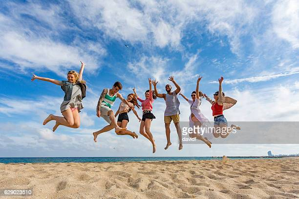 Celebrating Group of Friends Jumping at the Beach