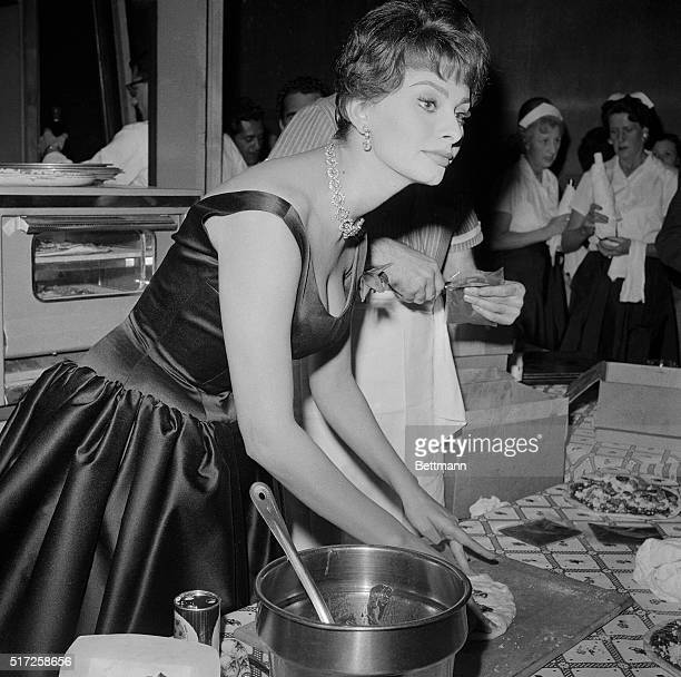 Celebrating her first year in America by tossing a 'thankyou' buffet supper for some 150 members of the foreign and domestic press corps in Hollywood...