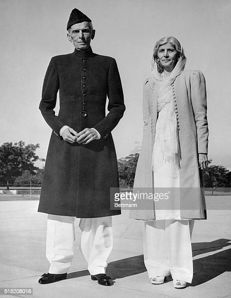 Celebrating his 72nd birthday Mohammed Ali Jinnah GovernorGeneral of Pakistan strolls on the lawn of the Government House at Karachi with his sister...