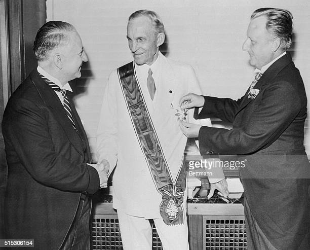 Celebrating his 75th birthday, Henry Ford receives the Grand Cross of the German Eagle for industrial accomplishments. It is presented by Karl Kapp,...