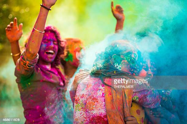 celebrating holi festival in india - holi stock pictures, royalty-free photos & images