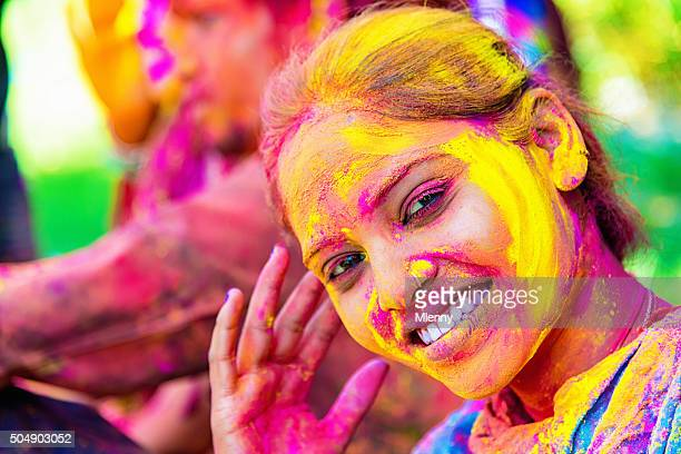 celebrating holi festival smiling indian girl india - indian beautiful girls stock photos and pictures