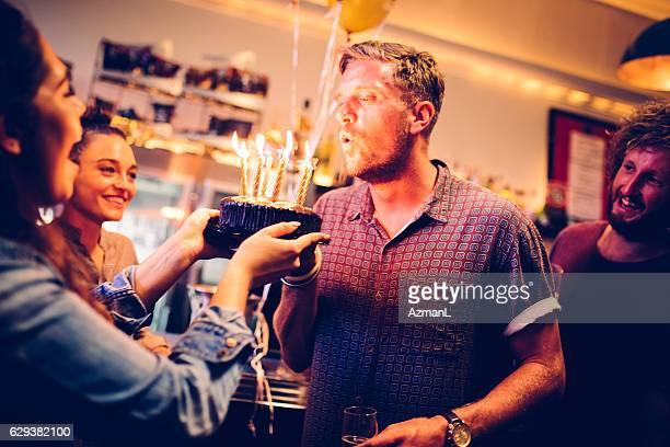 celebrating in a pub - happy birthday vintage stockfoto's en -beelden