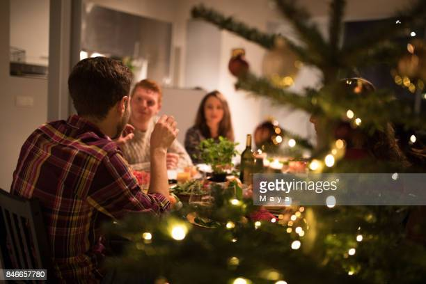 celebrating new year's eve with friends - christmas party stock photos and pictures