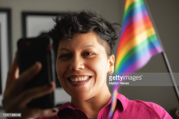 """celebrating pride with friends through video call - """"marilyn nieves"""" stock pictures, royalty-free photos & images"""