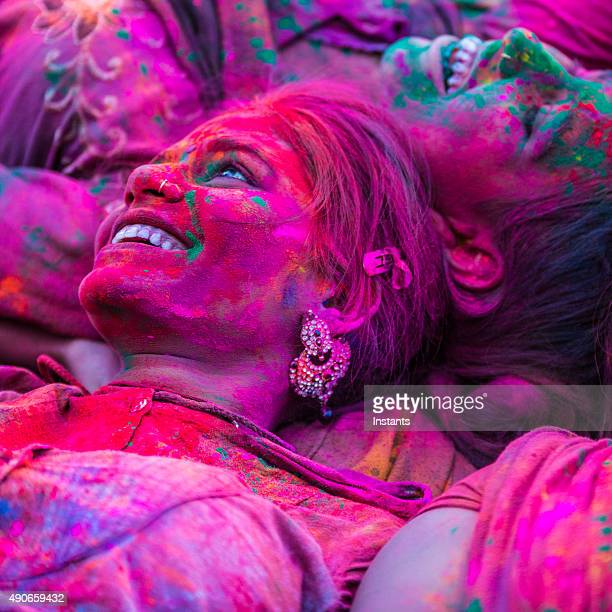 celebrating the holi festival of colors - holi stock pictures, royalty-free photos & images